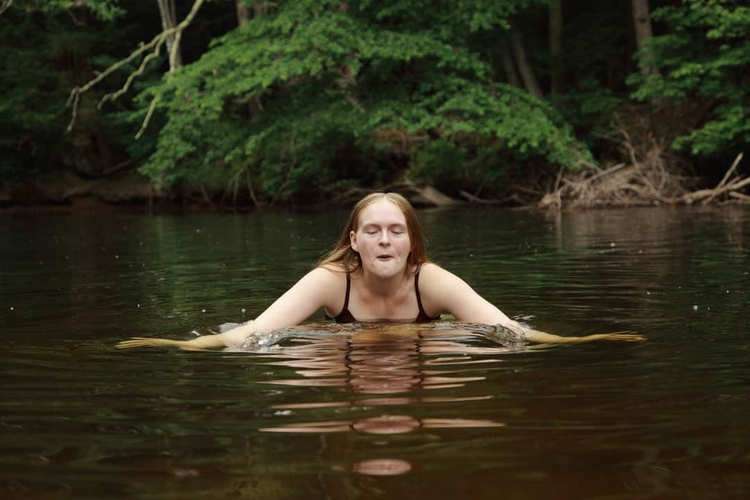 A person sitting next to a body of water